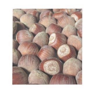 Autumn fruit Closeup of hazelnuts Food background Notepad