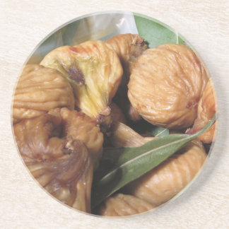 Autumn fruits . Closeup of dried figs with leaves Coaster