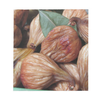 Autumn fruits . Closeup of dried figs with leaves Notepad