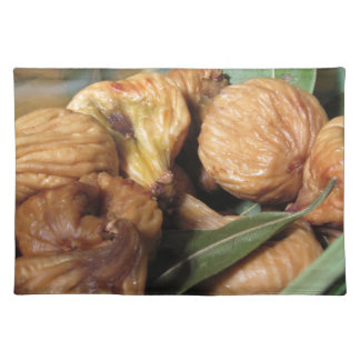 Autumn fruits . Closeup of dried figs with leaves Placemat