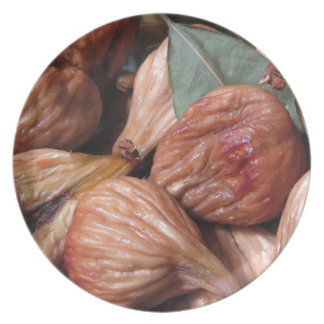 Autumn fruits . Closeup of dried figs with leaves Plate
