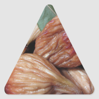 Autumn fruits . Closeup of dried figs with leaves Triangle Sticker