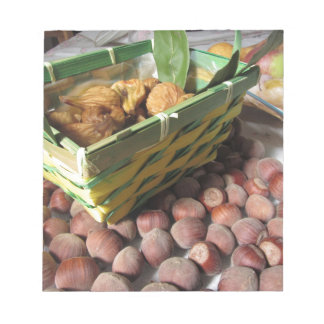Autumn fruits with hazelnuts and dried figs notepad