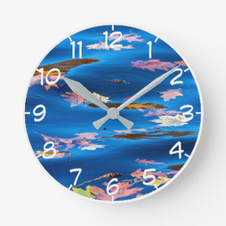 Autumn Leaves on Blue Water Round Clock