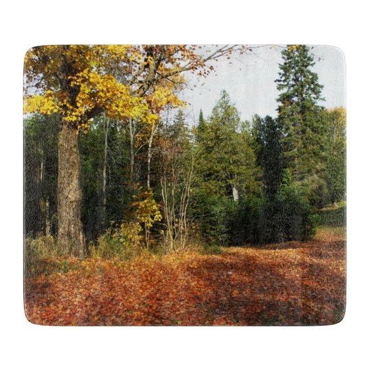 Autumn Leaves on ground Cutting Board