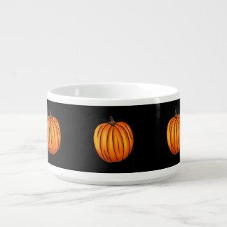 Autumn pumpkins on black bowl