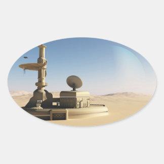 Avant-poste futuriste de désert de la science sticker ovale