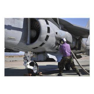 Aviation fuel technician attaches a fuel line art photo