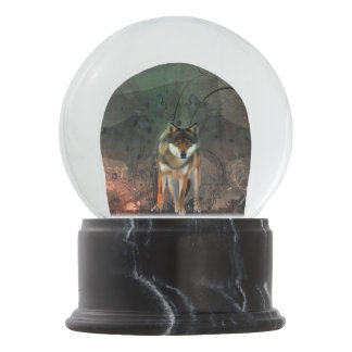 Awesome wolf on vintage background snow globe