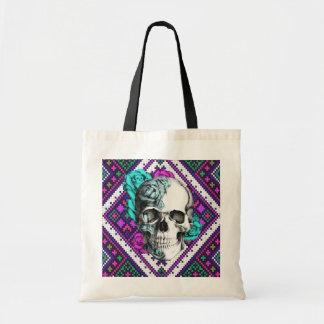 Aztec Rose skull on tribal pixel pattern. Tote Bags