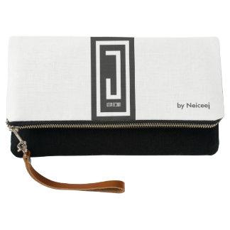 b/w clutch with black j wear design emblem
