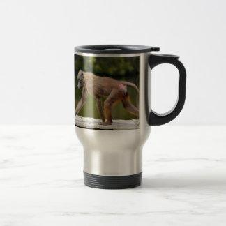 Baboon walking on wooden plancks travel mug