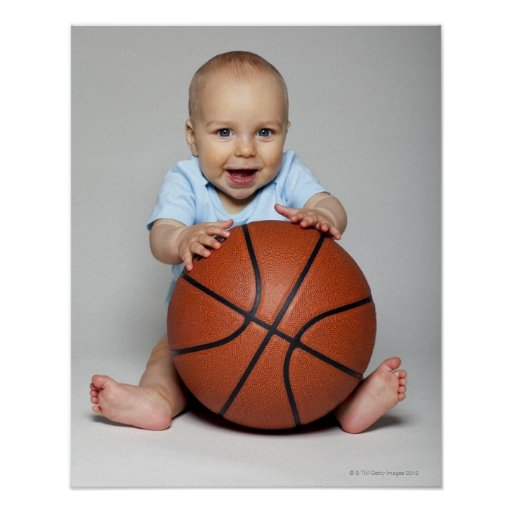 Baby boy (6-9 months) holding basketball, poster