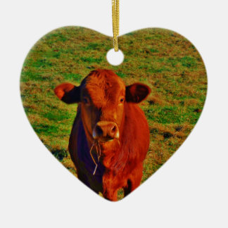 BABY BROWN COW EATING CERAMIC ORNAMENT