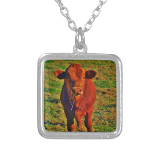 BABY BROWN COW EATING PENDANT