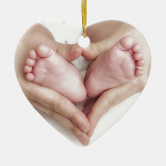 Baby feet in mother hands ceramic ornament