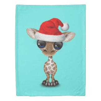 Baby Giraffe Wearing a Santa Hat Duvet Cover