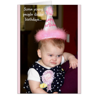 Baby looking grumpy at her first birthday party card