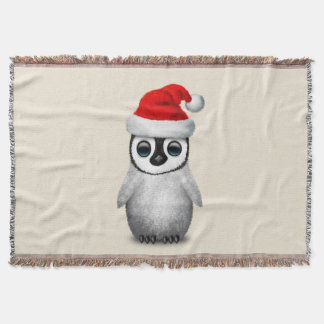 Baby Penguin Wearing a Santa Hat Throw Blanket