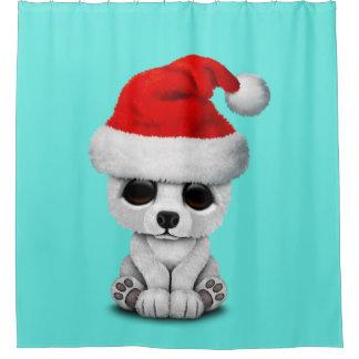 Baby Polar Bear Wearing a Santa Hat
