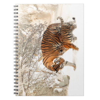 Baby tiger and Tiger mom in a snowy forest Notebooks