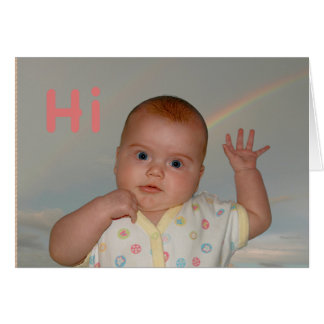 """Baby waving with """"Hi"""" on a greeting card"""