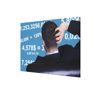 Back portrait of a businessman confused with canvas prints
