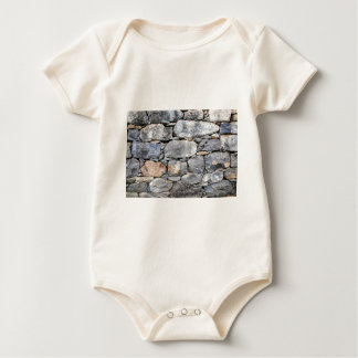 Backgound of natural stones as wall baby bodysuit