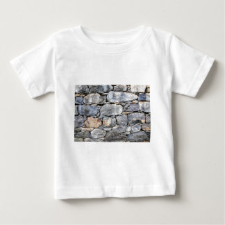 Backgound of natural stones as wall baby T-Shirt