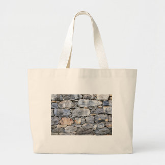 Backgound of natural stones as wall large tote bag
