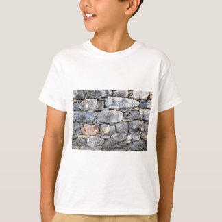 Backgound of natural stones as wall T-Shirt