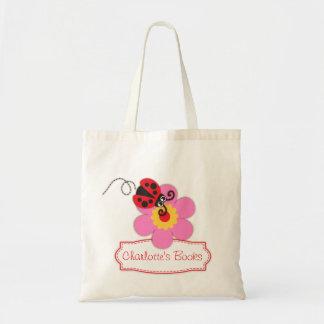 Badine le sac rouge de bibliothèque de fleur de