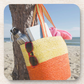 Bag Hanging On Tree Trunk At Sandy Beach Coaster