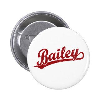 Bailey script logo in red 2 inch round button