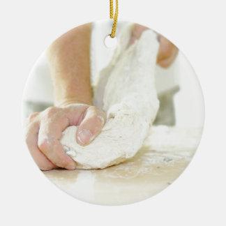 Baker kneading dough round ceramic ornament