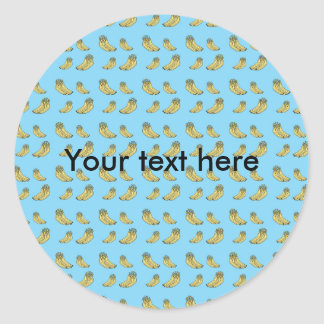 Banana pattern on blue background classic round sticker