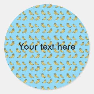 Banana pattern on blue background round sticker