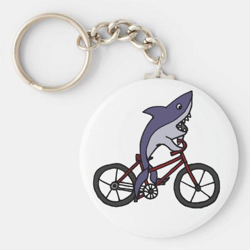 Bande dessinée idiote de bicyclette d'équitation d porte-clé