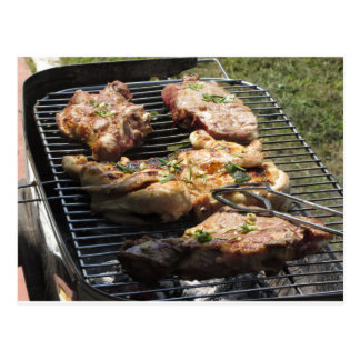 Barbecued steak and chicken on the grill postcard