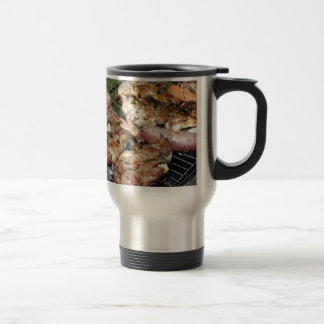 Barbecued steak and sausages on the grill travel mug