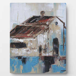 Barn with antique and rustic hues of turquoise plaque