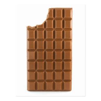 Barre de chocolat avec une carte postale absente d