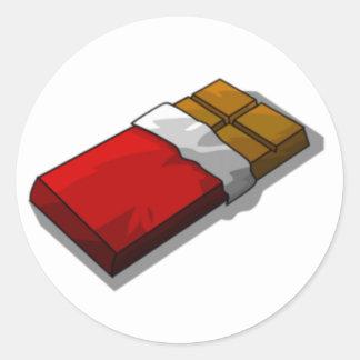 Barre de chocolat en emballage rouge sticker rond