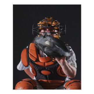 Baseball catcher holding ball in mitt poster