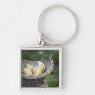 Basket of freshly picked pears. Silver-Colored square keychain