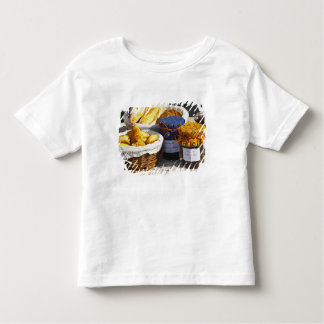 Basket with croissants and chocolate breads. toddler t-shirt