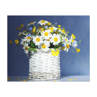 Basket with spring flowers canvas print