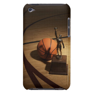 Basketball and trophy on basketball court, barely there iPod cases
