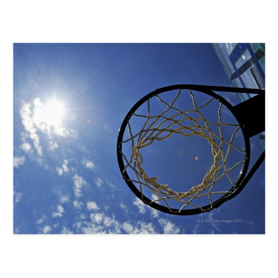 Basketball Hoop and the Sun, against blue sky Postcard