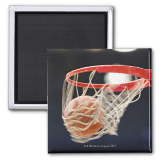 Basketball in basket. magnet